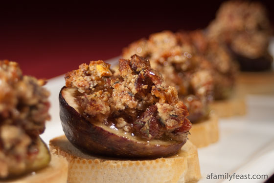 A delicious baked fig crostini with bacon, goat cheese, pecans, thyme and honey.