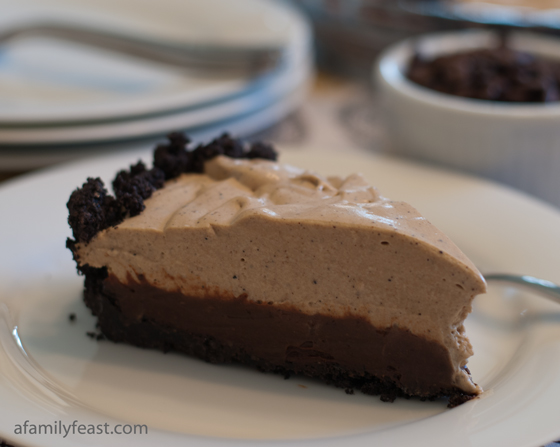 Espresso Black Bottom Pie - An amazingly good pie with an Oreo crust and chocolate mousse filling topped with espresso-infused whipped cream.