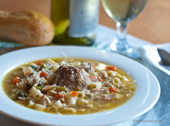 Italian Chicken Soup with Meatballs and Escarole - A delicious and hearty Italian chicken soup with meatballs, escarole, vegetables, and pasta. Also called Italian Wedding Soup.