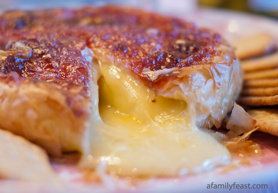 Baked Brie wrapped in phyllo dough and jam. A delicious and gooey appetizer, plus it's gorgeous to look at!