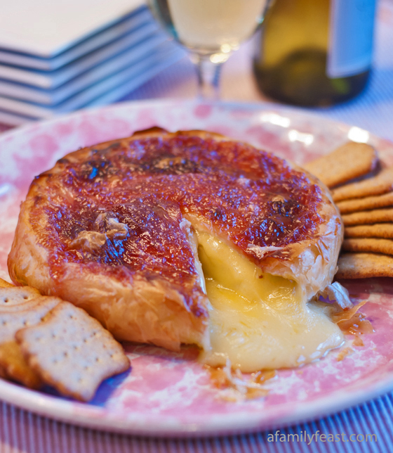Baked Brie wrapped in phyllo dough and jam. A delicious and gooey ...
