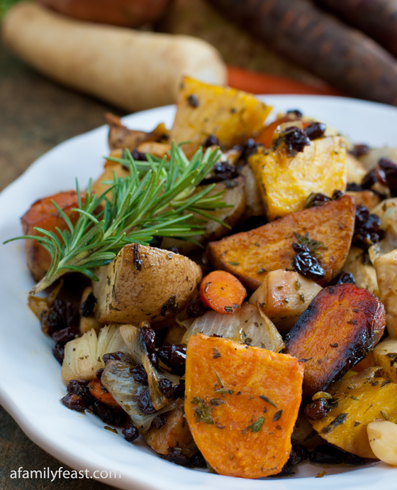 A delicious medley of roasted root vegetables including potatoes, sweet potatoes, parsnip, celery root, and beets.