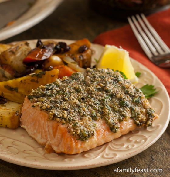 A moist and flavorful Herb Basted Salmon with fresh herbs, lemon and almonds.