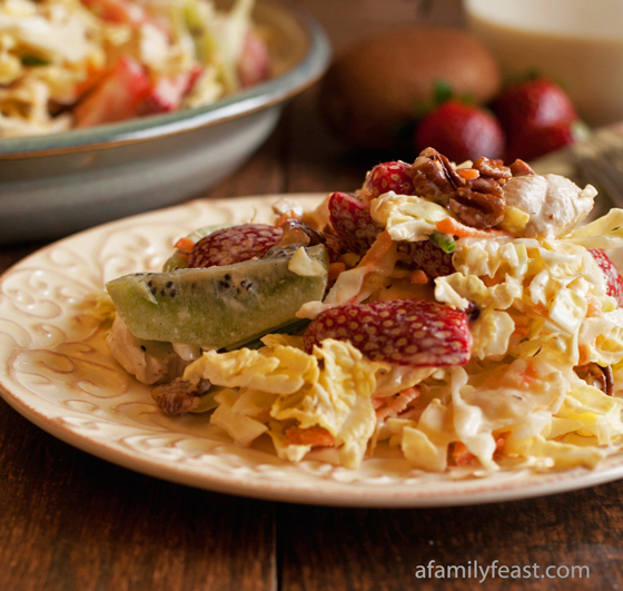 A quick and easy California Slaw recipe made with chicken, cabbage, strawberries, kiwi - all tossed with a honey-Dijon ranch dressing. Healthy and delicious!