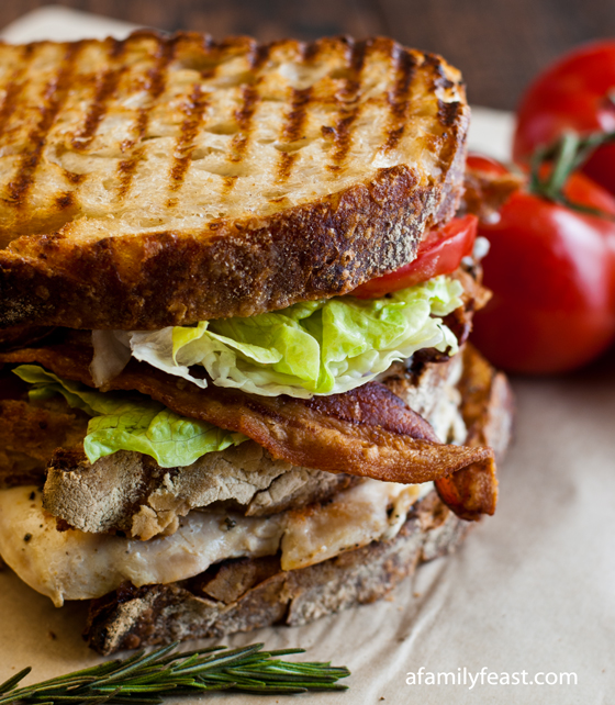 Grilled Chicken Club with Rosemary Aioli - A delicious club sandwich made with grilled chicken,bacon, lettuce, tomato, and a rosemary aioli.