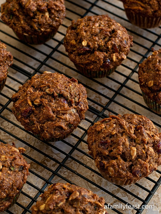 A recipe for Healthy Whole Wheat Muffins filled with dried cranberries, pineapple, shredded sweet potato, applesauce and sunflower seeds.
