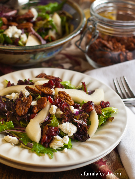 Mixed Greens with Pears, Goat Cheese, Dried Cranberries and Spiced Pecans - A delicious salad recipe made with mixed baby greens, pears, goat cheese, dried cranberries and amazing spiced pecans!