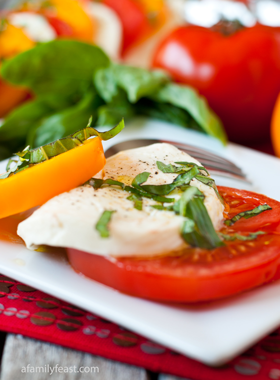 A simple recipe for Caprese Salad - fresh, garden tomatoes, mozzarella, basil -- so simple and so delicious!