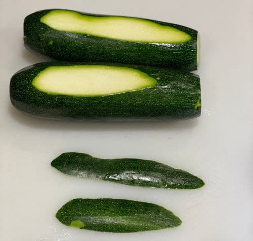 slice sliver off side of zucchini so it can lay flat