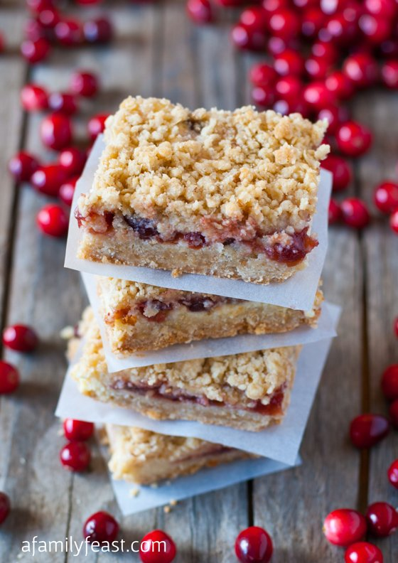 Oatmeal Cranberry Cheesecake Bars - a super delicious bar cookie with a oatmeal cookie crust, filling of cream cheese and cranberry sauce and a oatmeal crumble topping. These are really, really delicious!