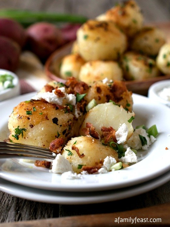 Rissole Potatoes - Simple and elegant potatoes cooked until they are crisp and golden on the outside and soft and creamy on the inside. Sprinkled with queso fresco, chives and bacon for extra flavor!