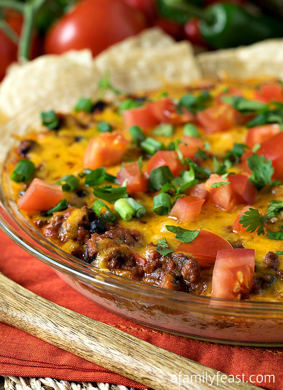 The most amazing Chili Dip recipe you will ever make! Prepare to make a double recipe - this will be the dish that everyone will want to eat at your next game day party! Guaranteed!