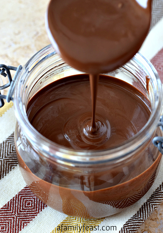 Homemade Magic Shell - It's so simple to make this recipe at home! Just two ingredients. Have fun pouring it over ice cream or creating your own chocolate-covered ice cream pops!