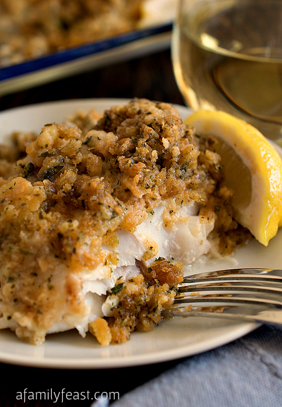 Cheesy Baked Stuffed Cod. A super moist and delicious fish recipe with a buttery crumb topping. One of our family's favorite meals!