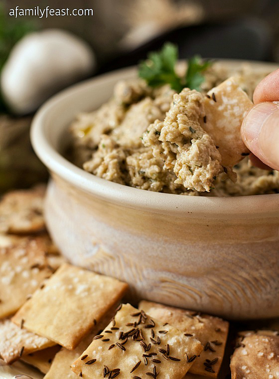 A delicious Roasted Eggplant and White Bean Dip served with savory Caraway Crackers. So delicious!