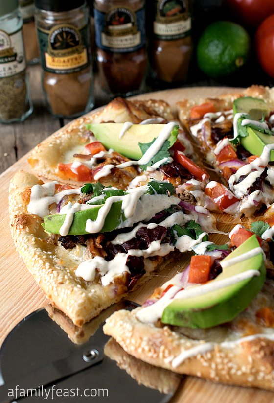 Cemita Pulled Pork Pizza - The commonly used flavors and ingredients of a cemita sandwich – turned it into a pizza with layer upon layer of fantastic zesty flavors!