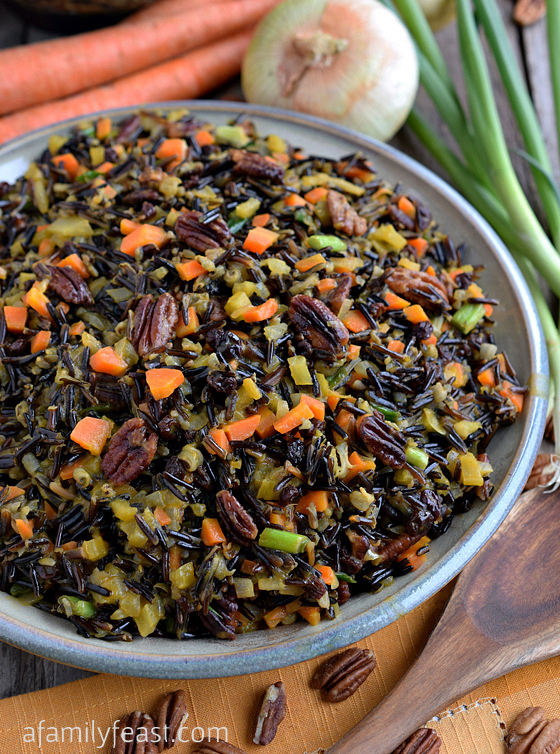 The best Wild Rice recipe! Tender wild rice tossed with vegetables, currants and pecans and cooked in an orange-vermouth broth. Very delicious!