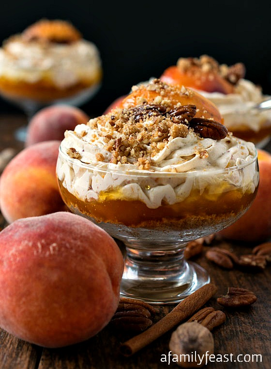 No-Bake Peach Cheesecake Mousse - A simple yet impressive dessert. Layers of sweet graham cracker crumbs, peach preserves, and a creamy and spicy peach cheesecake mousse!