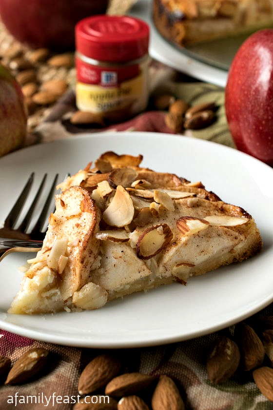 A delicious fresh apple torte with a sweet shortbread crust and cream cheese filling topped with sweet cinnamon apples and almonds.