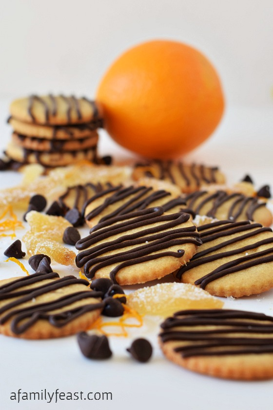 Orange and Ginger Cookies with Chocolate Drizzle - A sweet orange sugar cookie with crystallized ginger added for some sweet spiciness - plus orange-chocolate drizzle over the top!  So delicious!