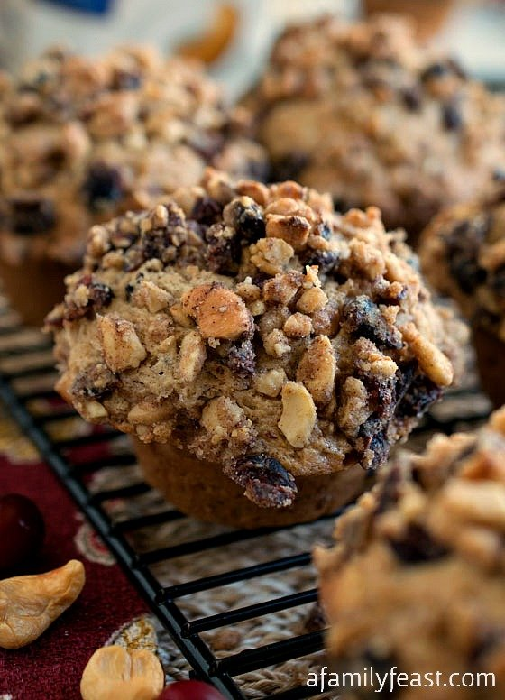 Cashew Cranberry Crunch Muffins - Super moist cinnamon muffins full of cashews and cranberries with an incredible streusel topping! @LoveMySilk #SilkCashew #sponsored