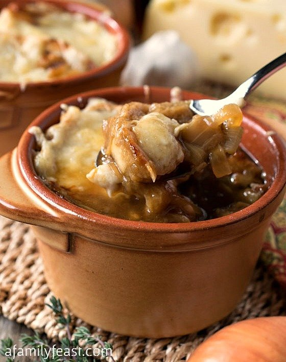 Quite possibly one of the best French Onion Soup recipes around! Super rich and flavorful with crusty toasted bread and melted Swiss cheese. YUM!