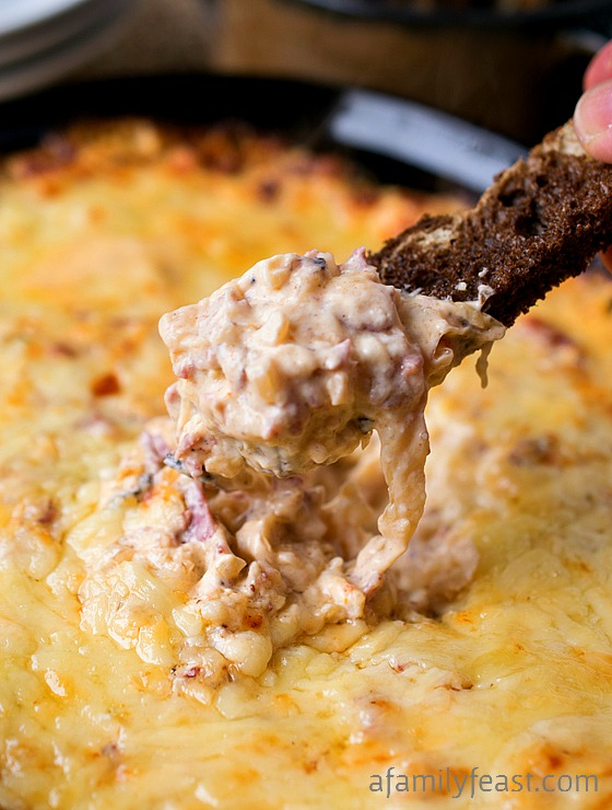 This Reuben Dip is perfect for game day! A combination of both pastrami AND corned beef, plus sauerkraut in an incredible cheesy sauce! Served with rye or pumpernickel toast - so good!