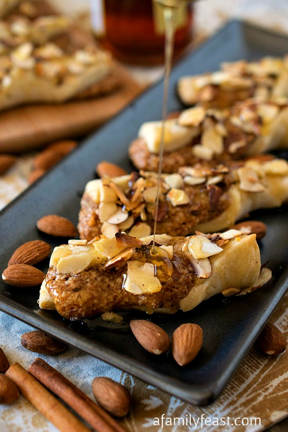 Sicilian Twists - A rich sweet Italian shortbread cookie with an almond, cinnamon and honey filling and topped with a drizzle of honey and more toasted almonds. Perfectly sweet and delicious!