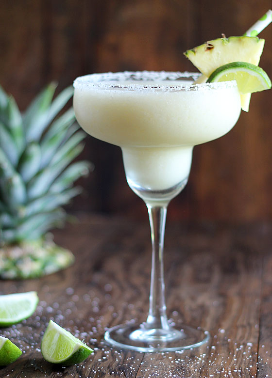 This coconut pineapple margarita is one of over 30 refreshing margarita recipes in a collection on afamilyfeast.com