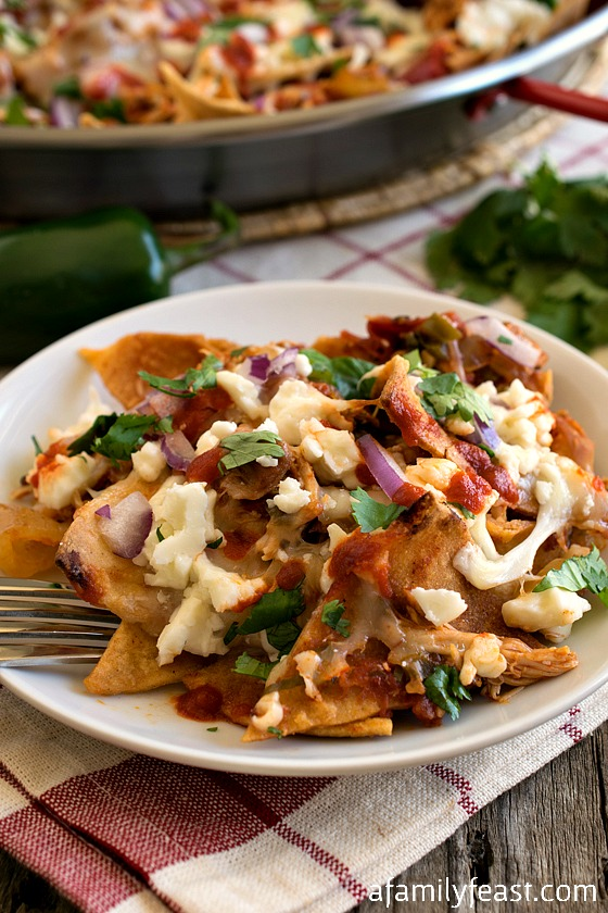 Pulled Chicken Chilaquiles - A fantastic dish made with corn tortillas, pulled chicken, and melted cheese.  Perfect for Cinco de Mayo!