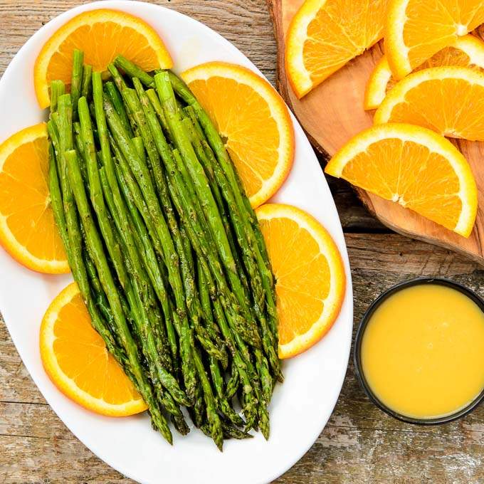 Roasted Asparagus with Orange Glaze - One of over 30 Amazing Asparagus Recipes to give you cooking inspiration this Spring! See the collection on A Family Feast