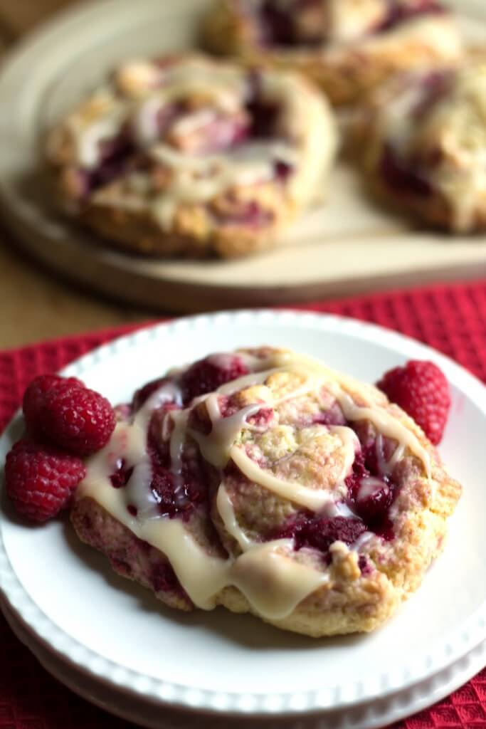 Iced Raspberry Scones - One of over 30 beautiful brunch recipes for Mother's Day, or any special occasion! The collection includes main dishes, appetizers, drinks, and desserts. | A Family Feast