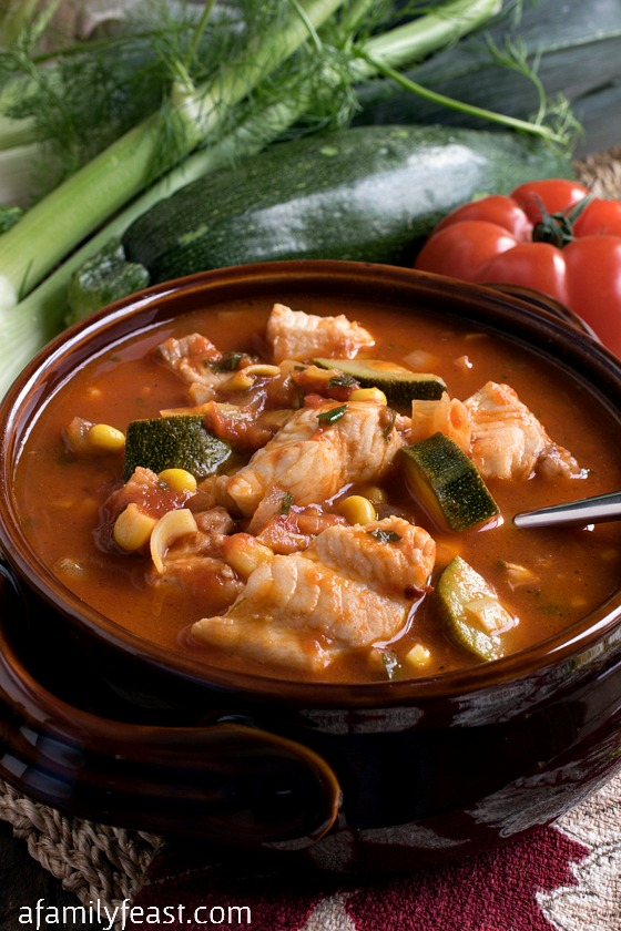 Italian Fish Stew - A taste of the coast in a bowl! Tender chunks of white fish in a tomato broth with fresh garden vegetables. Wonderful with warm crusty bread!