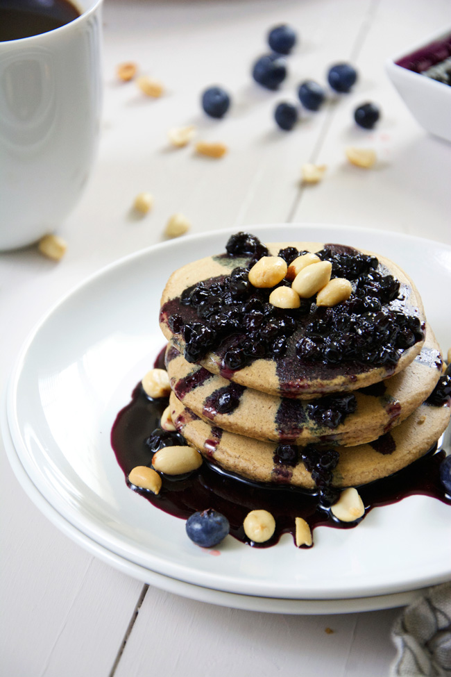 Oatmeal Peanut Butter Pancakes with Blueberry Glaze - One of over 20 delicious peanut butter and jelly recipes for Peanut Butter Jelly Time on A Family Feast