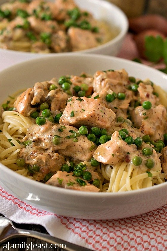 Creamed Salmon and Peas Over Linguini - Tender chunks of salmon sautéed in a wonderful cream and mustard sauce that is flavored with pancetta and shallots, then served over linguini. (It's incredible!)