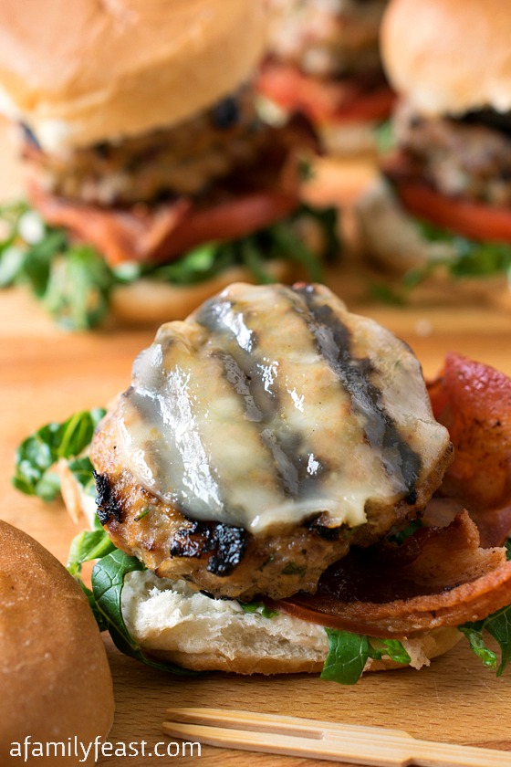 Stuffed Veal Sliders - Seriously - these are some of the best burgers you'll ever eat! Super flavorful, tender and moist veal burgers stuffed with cheese and sun dried tomatoes.