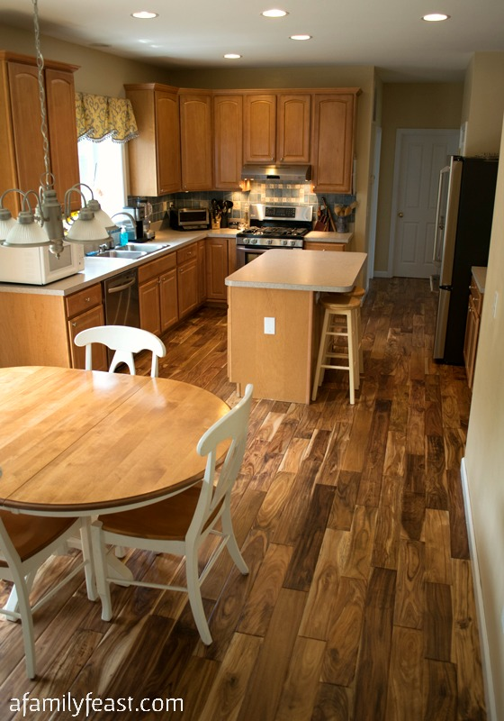 See the progress we've made with our Kitchen Makeover. The New Hardwood Floors in our kitchen have transformed the room!