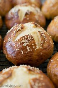 Soft Honey Sesame Pretzel Rolls - A Family Feast