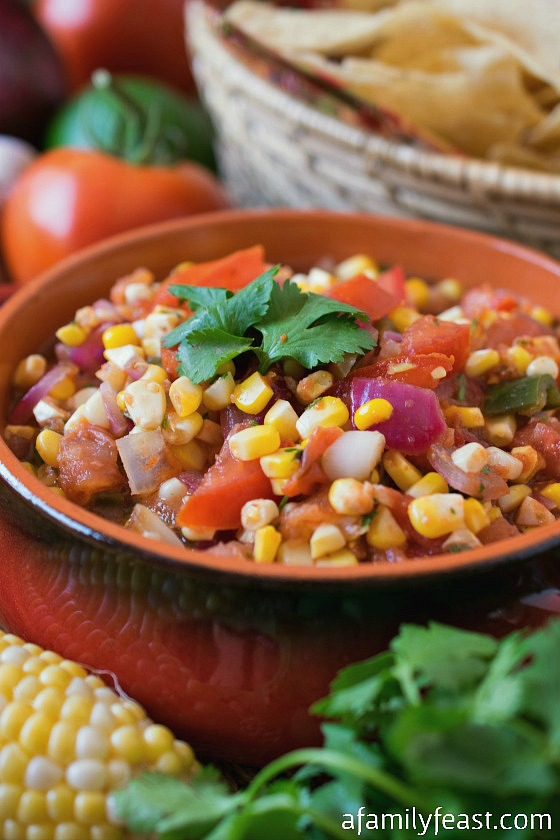 Grilled Corn and Tomato Salsa - Incredible flavor and simple to make! Perfect for summertime parties!