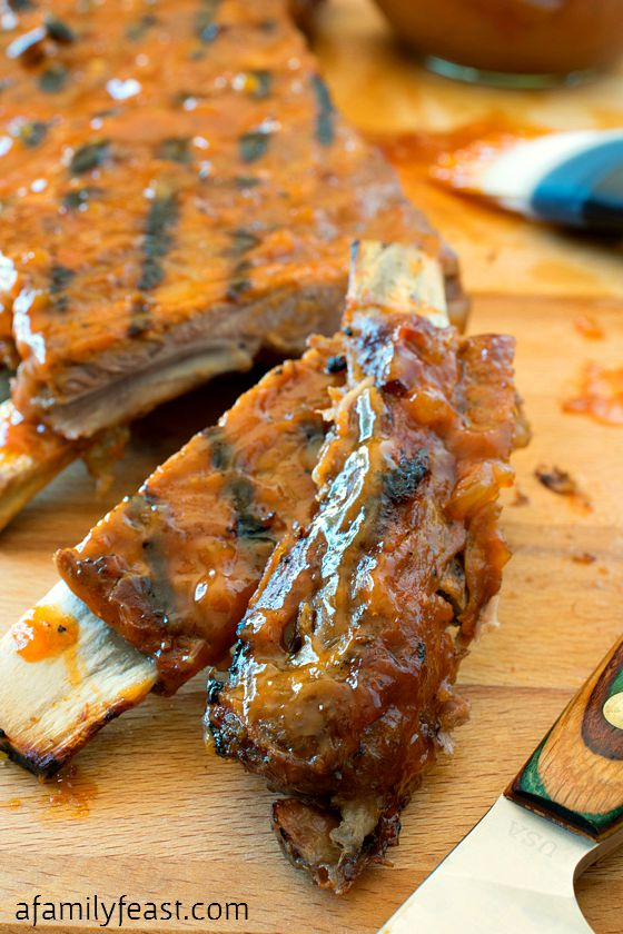 Barbecue Pork Ribs - Some of the best ribs you'll ever eat! Fall-off-the-bones tender pork ribs slathered in a barbecue sauce recipe that has been passed down through generations!