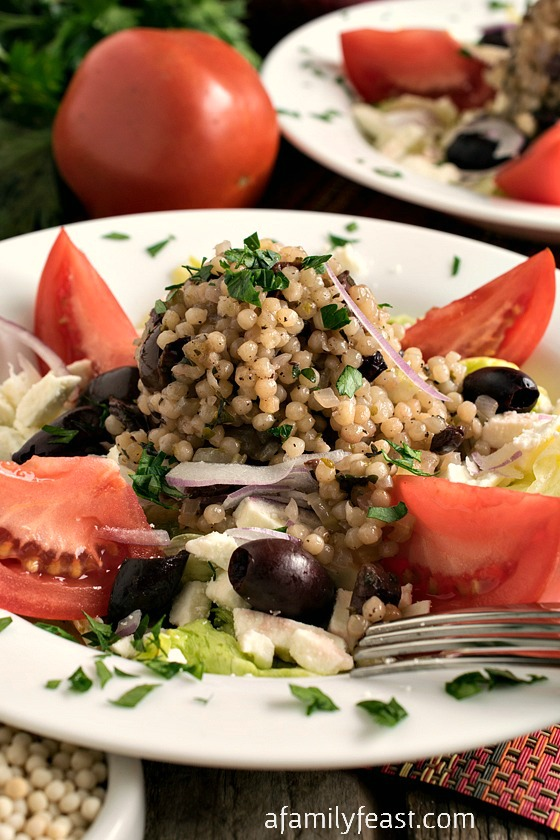 Mediterranean Israeli Couscous Salad - A zesty hot-cold salad with fantastic flavor. This looks fancy but is super simple to make!