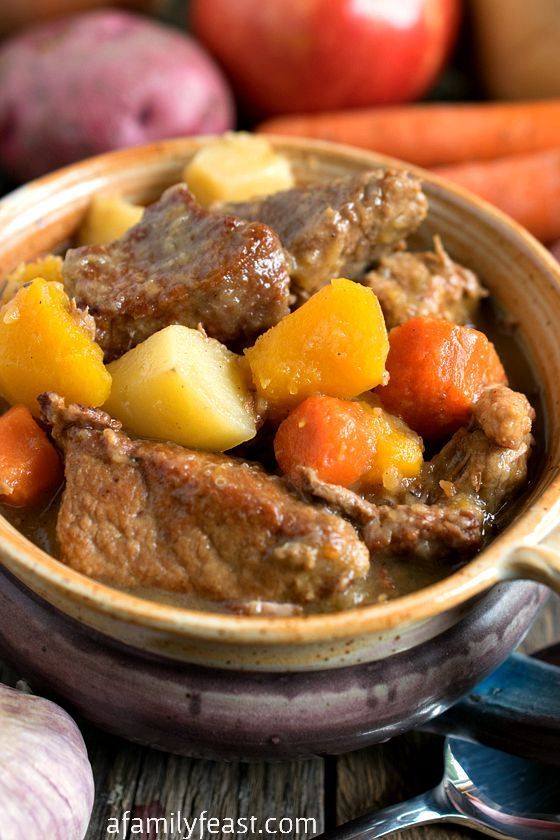 Autumn Pork Stew - Tender chunks of pork, apples, potatoes and butternut squash are combined to create the ultimate comfort food!