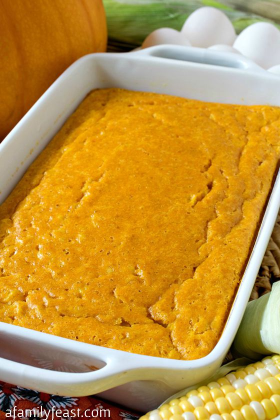 Pumpkin Corn Pudding - Your guests will want seconds! A delicious twist on a classic corn pudding - we add pumpkin to the custard and the results are fantastic!