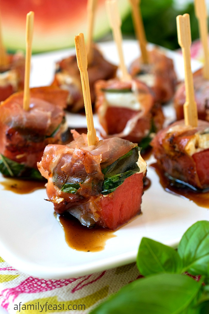 Grilled Watermelon Bites - Chunks of watermelon layered with goat cheese and basil, then wrapped in salty prosciutto. This unique summer appetizer is a must-make recipe!