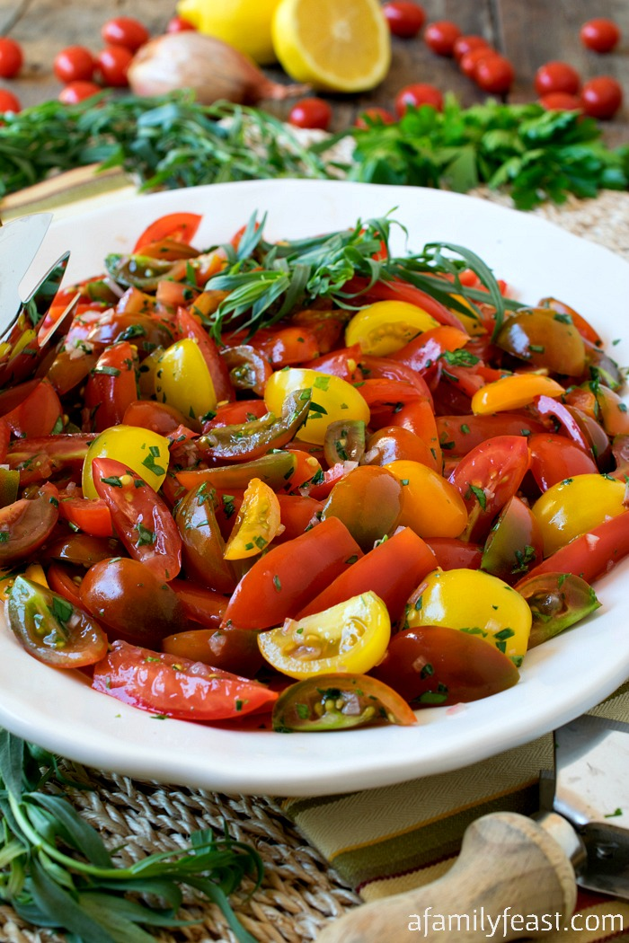Herbed Tomatoes - A mix of fresh herbs transforms the flavor of cherry tomatoes in this easy summer side dish!