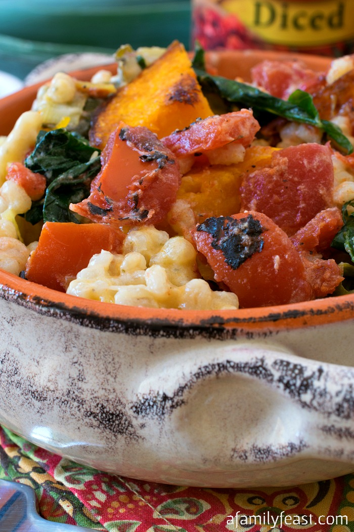 Fire Roasted Tomato and Barley Risotto - A creamy barley risotto loaded with fire roasted tomatoes, butternut squash and kale. Super comforting and delicious!