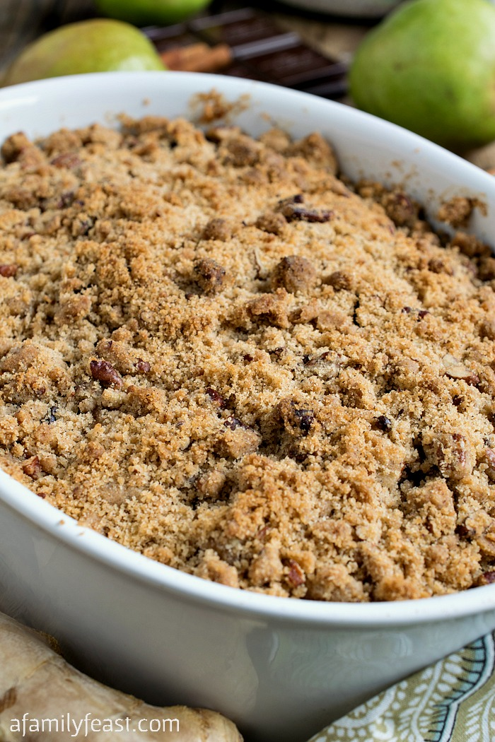 Pear and Dark Chocolate Crisp - A very special dessert! Chunks of fresh pear and fresh ginger, plus a layer of chocolate nestled under a spicy pecan crumb topping.
