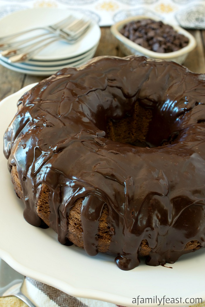 Kathy's Chocolate Chocolate Chip Cake is super moist and super easy! Delicious chocolate cake loaded with chocolate chips and a ganache frosting.