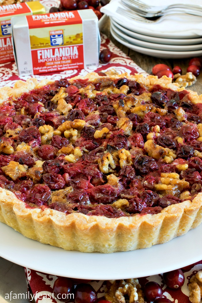 Cranberry Walnut Tart - A rich cranberry and walnut filling in a buttery shortbread shell. Perfectly sweet, tart and delicious!