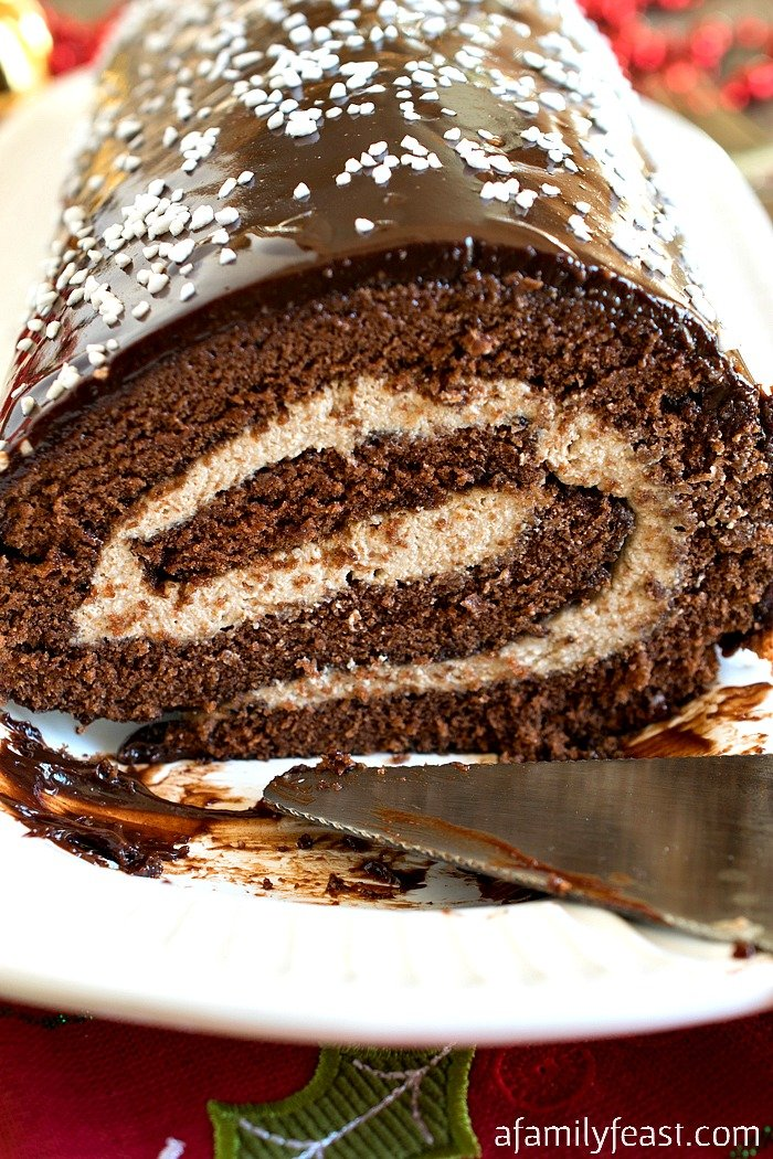 Malted Mocha Swiss Roll - Not your typical chocolate Swiss roll cake! Ours is filled with a malted espresso cream that is out of this world!